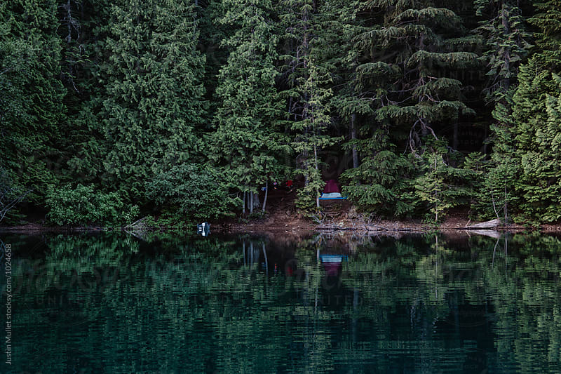 Hidden campsite on lake shore by Justin Mullet for Stocksy United
