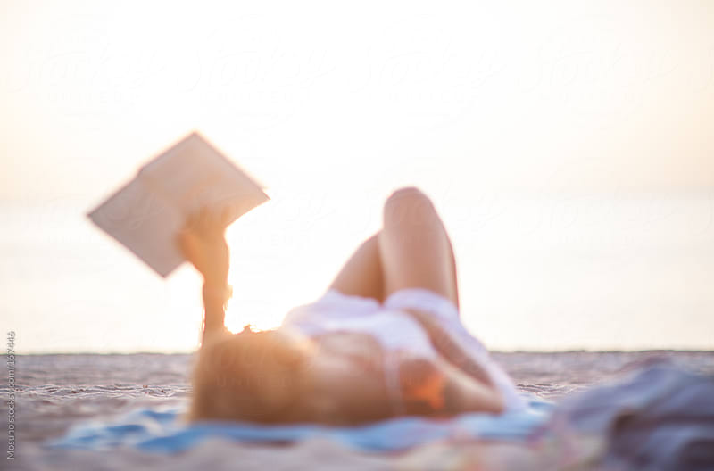Woman Reading a Book on the Beach by Mosuno for Stocksy United