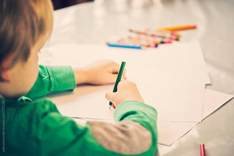 Child drawing a picture by sally anscombe for Stocksy United