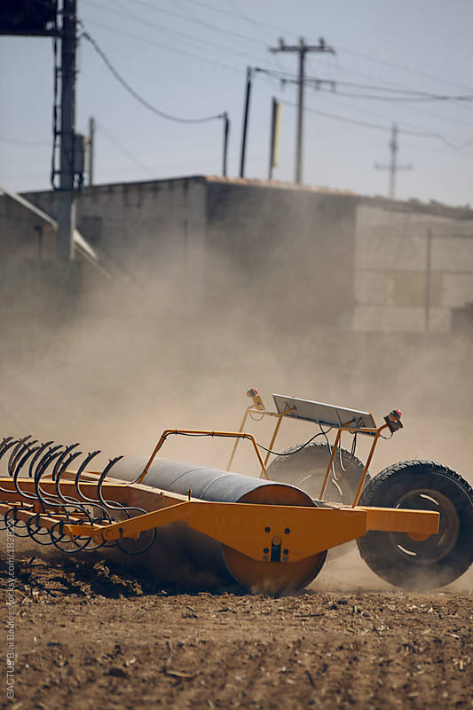 Tractor plowing a field by CACTUS Blai Baules for Stocksy United