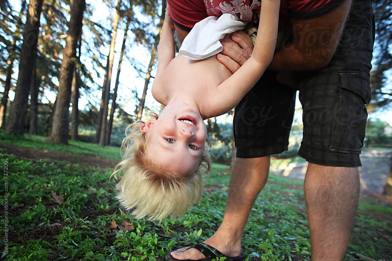 Blonde Boy Being Held Upside Down by Dad by Dina Giangregorio for Stocksy United