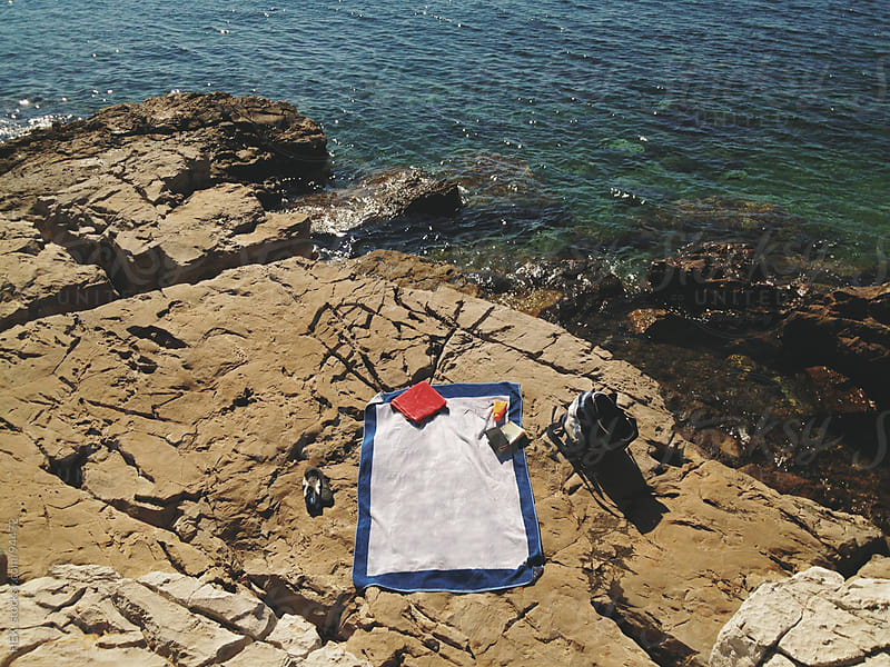 Beach Towel on Rocks by HEX. for Stocksy United