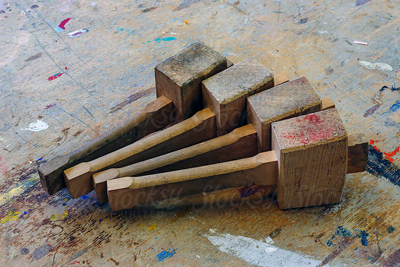 Wooden mallets used in a classroom for art and design. Placed on a school table by Paul Phillips for Stocksy United