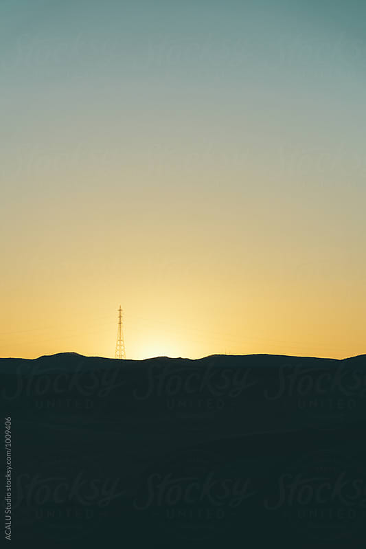 High voltage post at sunset by ACALU Studio for Stocksy United
