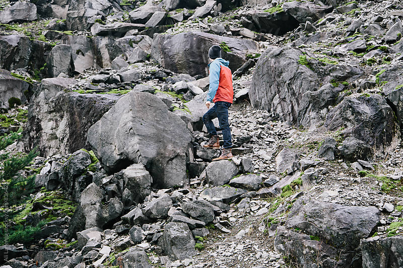 Cliffside climber by Ali Lanenga for Stocksy United