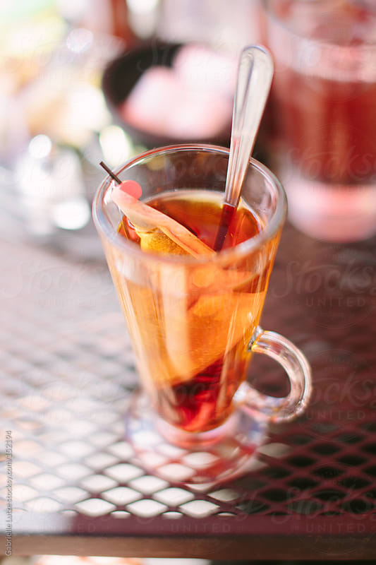 Iced Tea Outside at a Cafe  by Gabrielle Lutze for Stocksy United