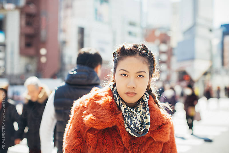 Sunny Outdoor Portrait of Young Pretty Asian Woman in Red Fur Coat by VISUALSPECTRUM for Stocksy United