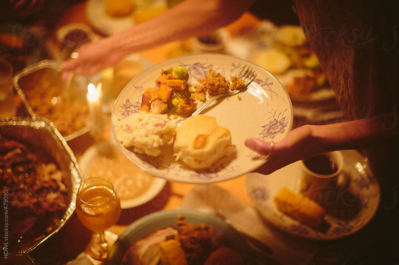A holiday dinner served among family and friends  by HOWL for Stocksy United