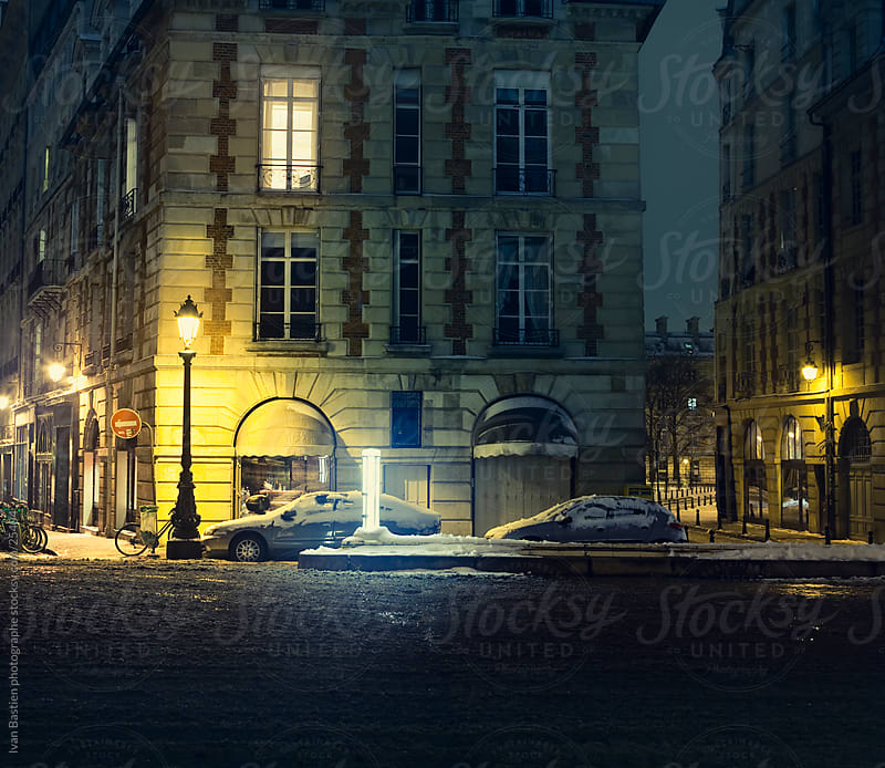 Street in Paris on a winter night by Ivan Bastien for Stocksy United
