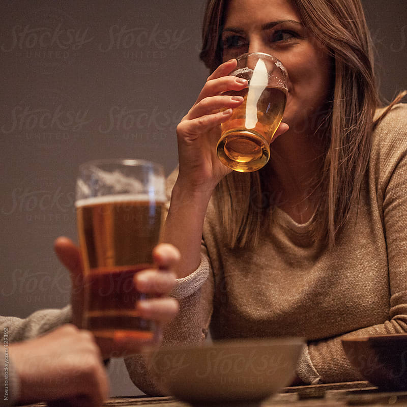 Young Woman Drinking Beer by Mosuno for Stocksy United