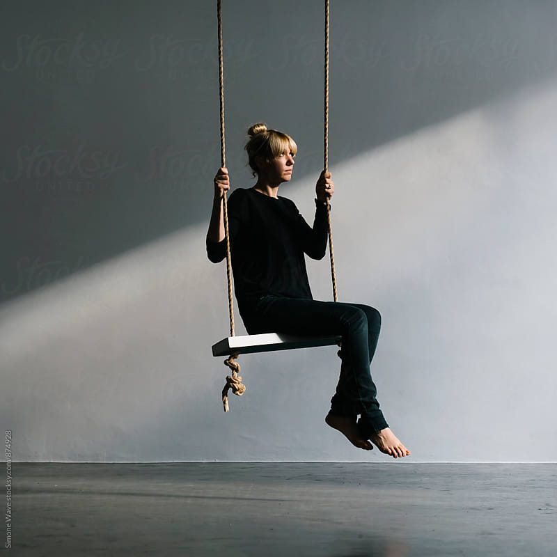 Woman on the swing by Simone Becchetti for Stocksy United