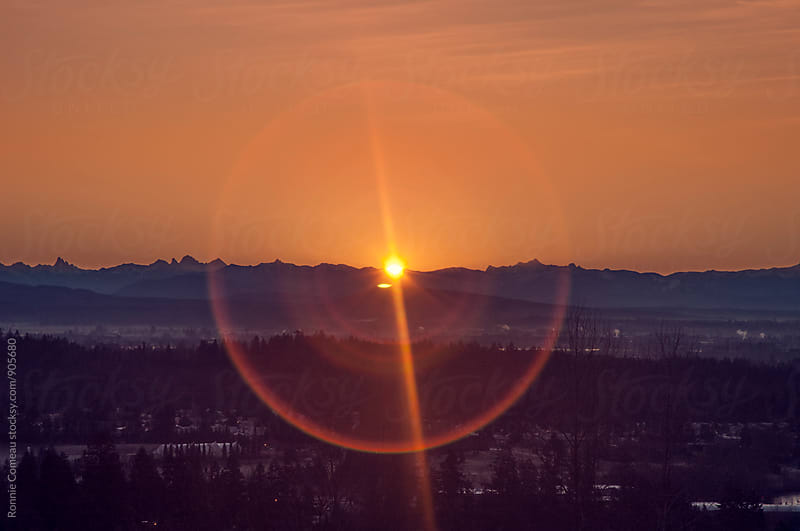 Sunrise Over Mountains Over City by Ronnie Comeau for Stocksy United