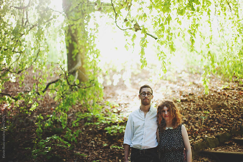 Backlit Tree Young Adult Couple by Kevin Russ for Stocksy United