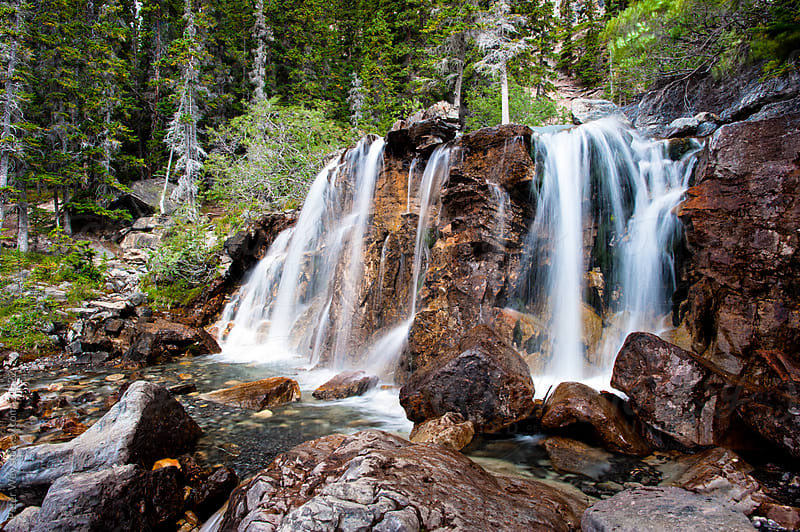 Waterfall in Jasper National Park: Tangle Creek Falls by Peter Wey for Stocksy United