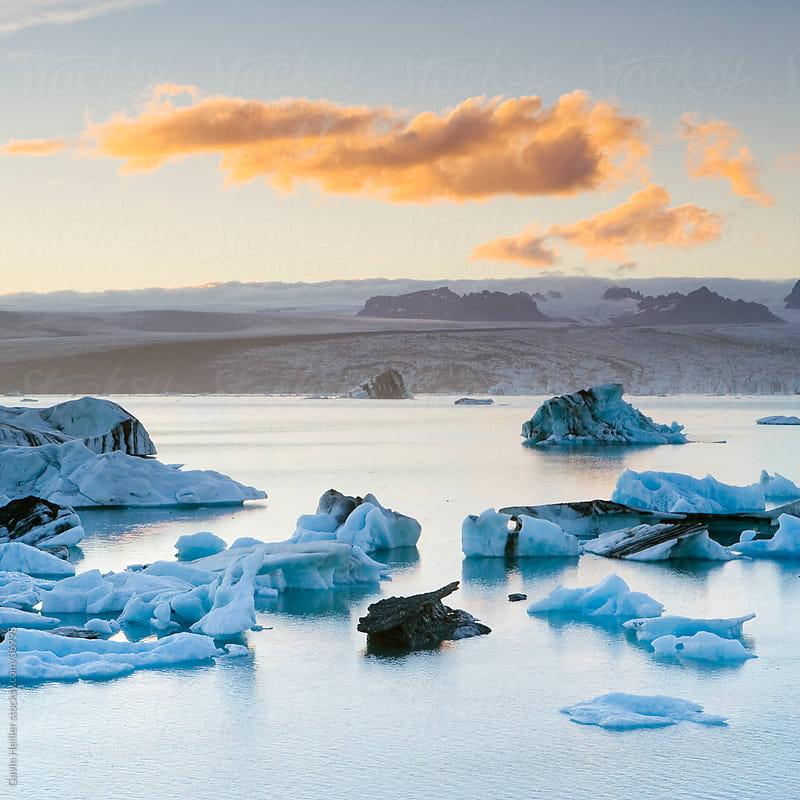 Iceland, southern Iceland, southern Vatnajokull, Jokulsarlon (Glacial River Lagoon), Icebergs floating in the Lagoon beneath Breidamerkurjokull Glacier by Gavin Hellier for Stocksy United