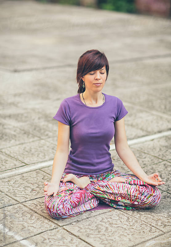 Woman Meditating on the Street by Lumina for Stocksy United
