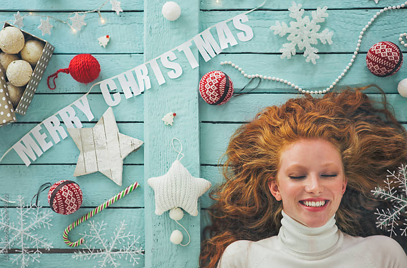 Merry Christmas! Smiling Woman Surrounded by Christmas Decoration by Lumina for Stocksy United