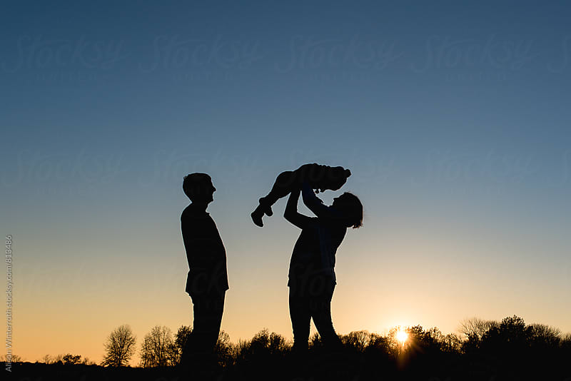 Silhouette Of A Family Of Three by Alison Winterroth for Stocksy United