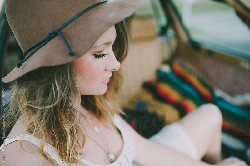 Pretty woman wearing hat looking down by Kristin Rogers Photography for Stocksy United