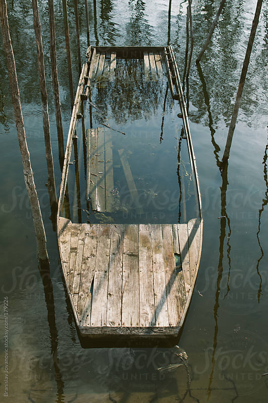 Wooden boat under the water by Brkati Krokodil for Stocksy United