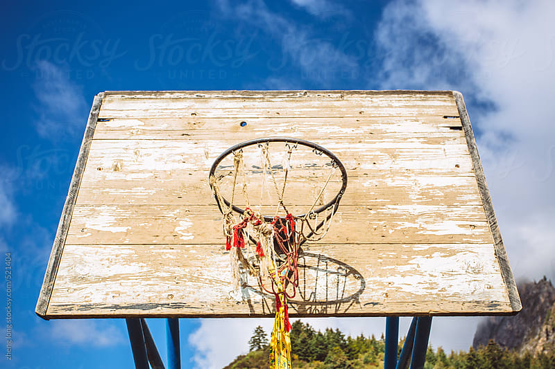 Basketball stands in the Tibet area,with prayer flags by zheng long for Stocksy United