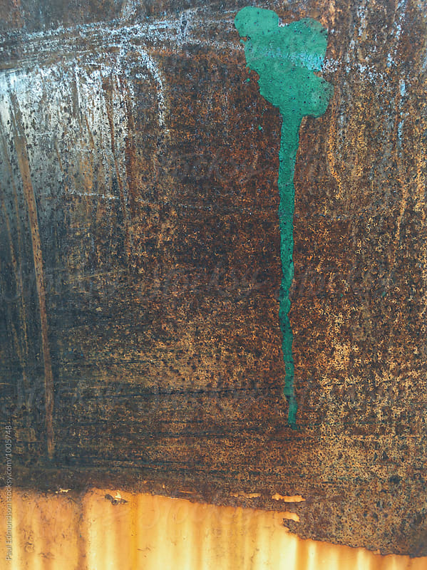 Green paint on rusty metal wall, close up by Paul Edmondson for Stocksy United