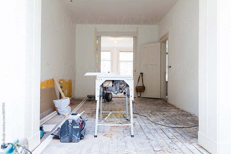A messy renovation going on in a house or apartment  by Ivo de Bruijn for Stocksy United