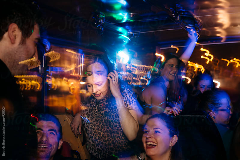 People having fun in a night club by Beatrix Boros for Stocksy United