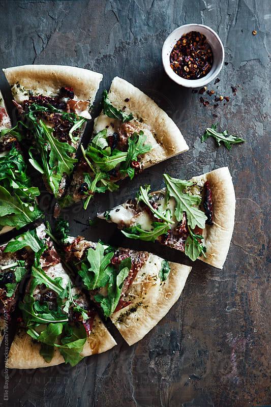 Prosciutto and arugula pizza by Ellie Baygulov for Stocksy United