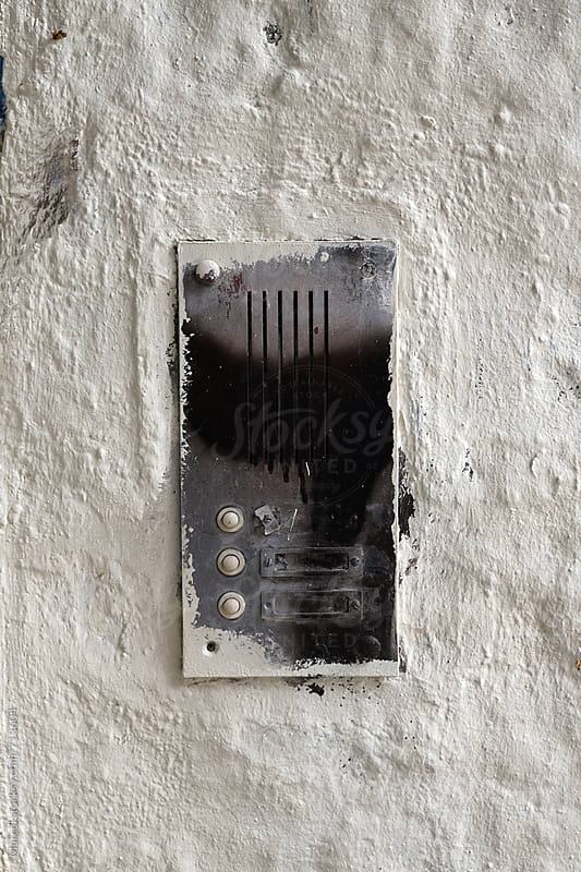 Doorbell on a wall by Marcel for Stocksy United