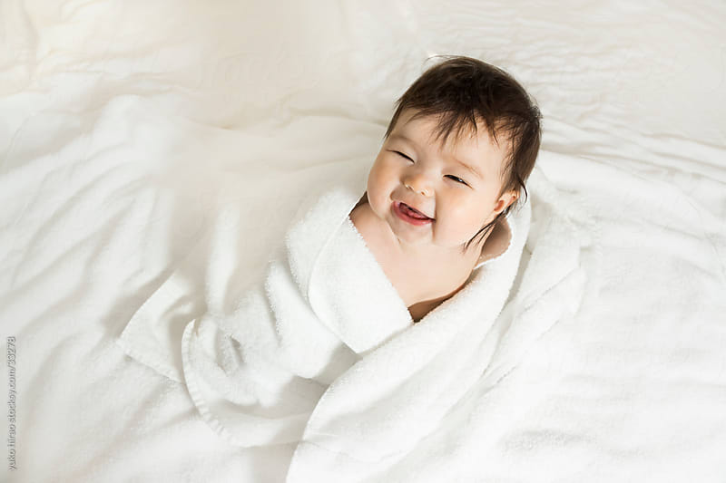 Happy baby girl wrapped in towels by yuko hirao for Stocksy United