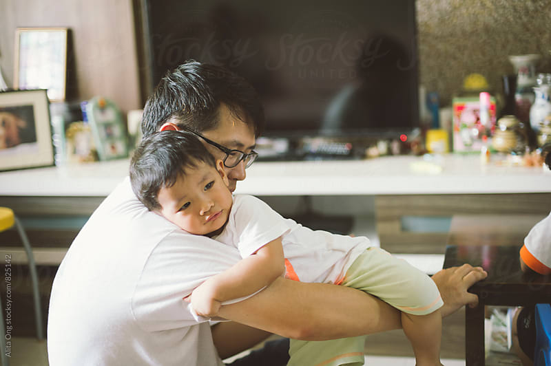 Dad and young son at home by Alita Ong for Stocksy United