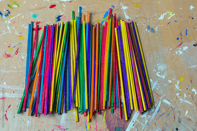 Vibrant craft sticks used in a school for art projects  by Paul Phillips for Stocksy United