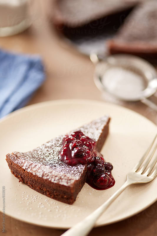 Chocolate cake with berries jam by Martí Sans for Stocksy United