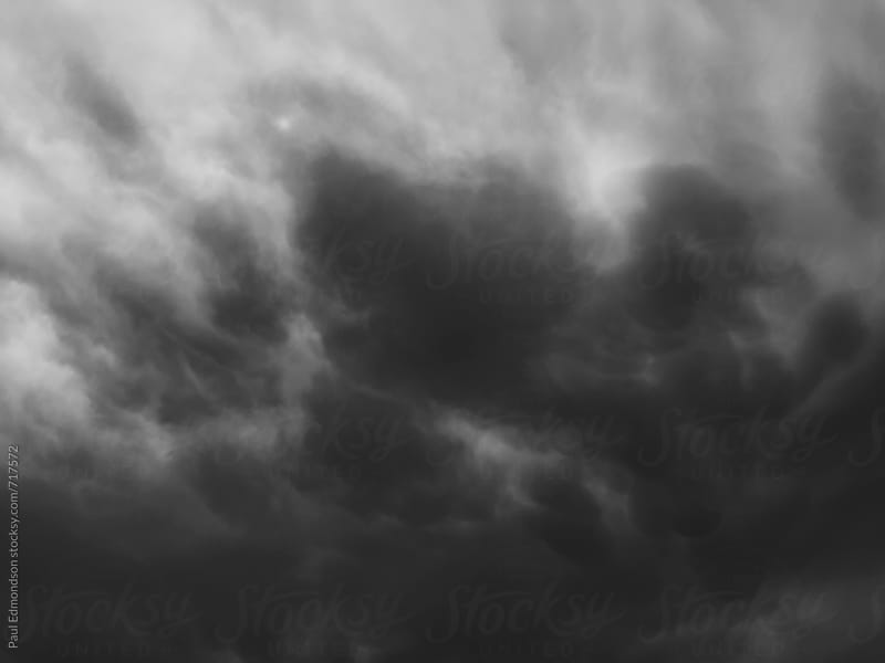 Ominous storm clouds by Paul Edmondson for Stocksy United