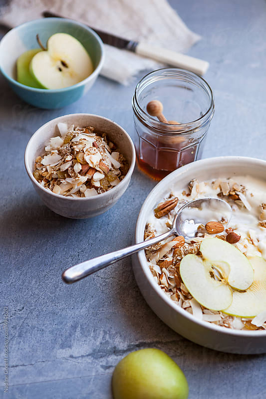 Breakfast Muesli with toasted coconut, seeds, nuts, apple and honey by Nadine Greeff for Stocksy United