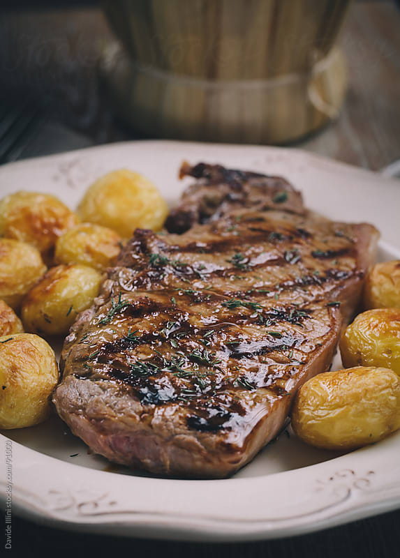 Beef steak with potatoes by Davide Illini for Stocksy United