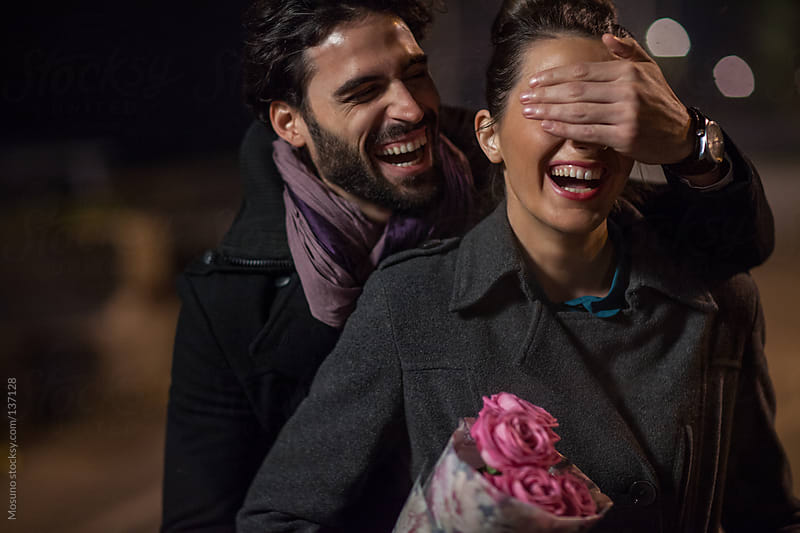 Man Surprises Woman for a Valentine's day by Mosuno for Stocksy United