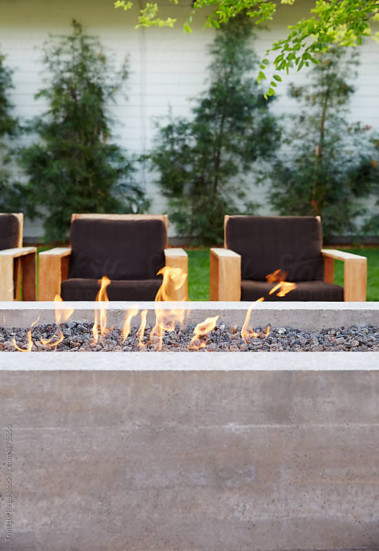 Outdoor fire pit at luxury hotel and resort  by Trinette Reed for Stocksy United