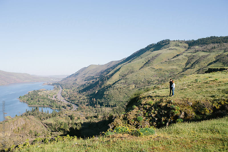 Man and woman on Rowena Crest, Oregon by KATIE + JOE for Stocksy United
