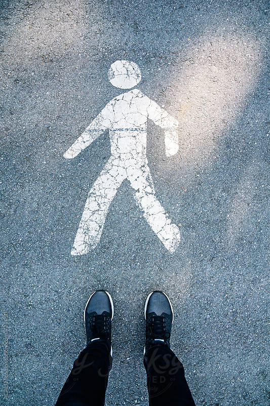 Symbol of a pedestrian on the pavement by ACALU Studio for Stocksy United