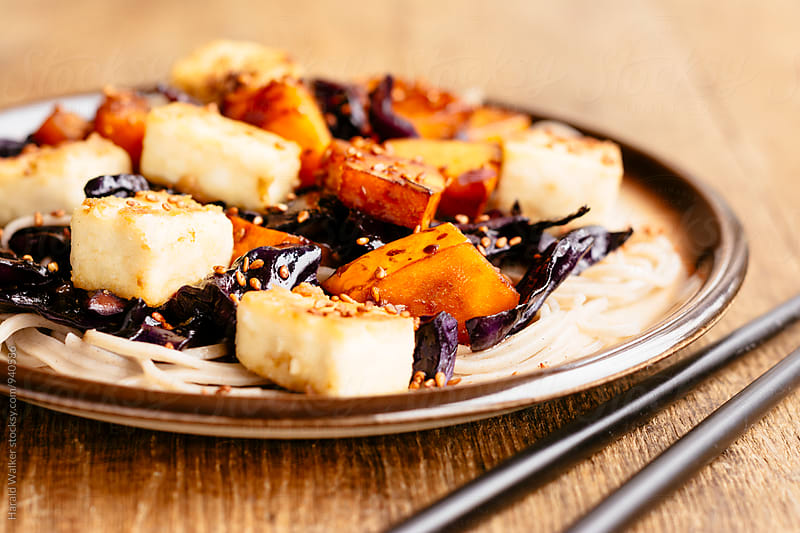 Stir-fried Tofu with Red Cabbage and Winter Squash by Harald Walker for Stocksy United