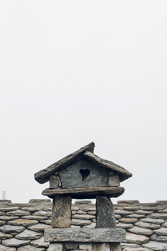 Chimney heart Detail of a Stone Cabin by Jordi Rulló for Stocksy United