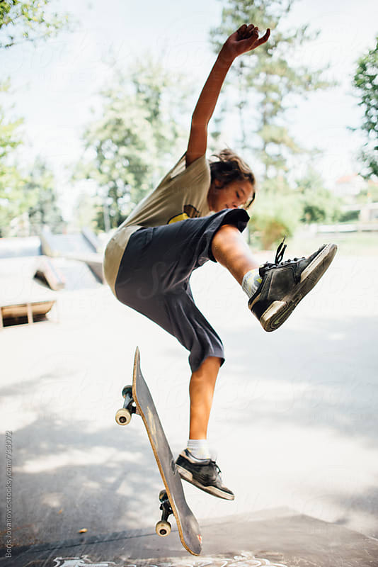 Boy jumping with skateboard  by Boris Jovanovic for Stocksy United