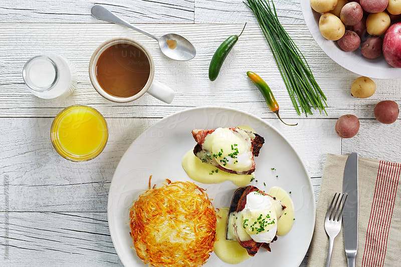 Eggs Benedict breakfast dish by Trinette Reed for Stocksy United