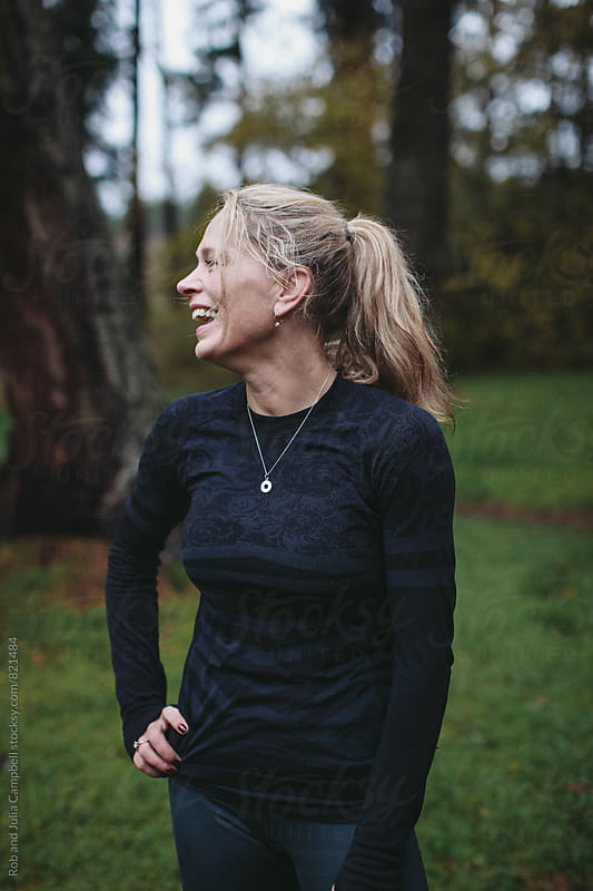 Post workout portrait of middle age caucasian woman - smiling outside by Rob and Julia Campbell for Stocksy United