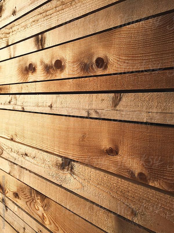 Detail of modern cedar fence by Paul Edmondson for Stocksy United