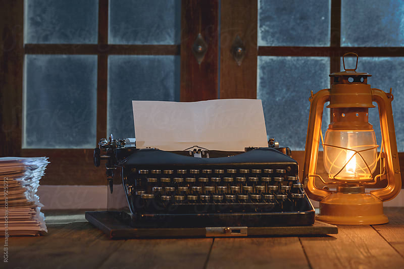 Writer's old typewriter on wooden desk by RG&B Images for Stocksy United