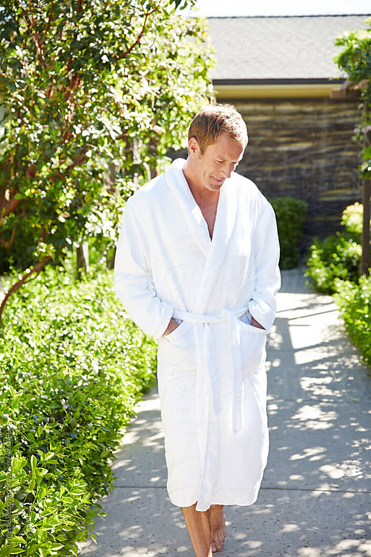 Man relaxing at luxury spa in bathrobe  by Trinette Reed for Stocksy United