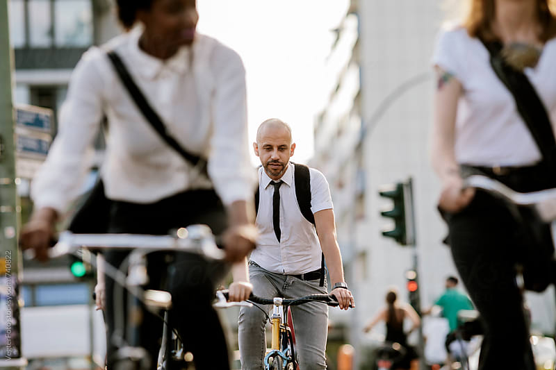Office workers commuting on Bicycles by VegterFoto for Stocksy United
